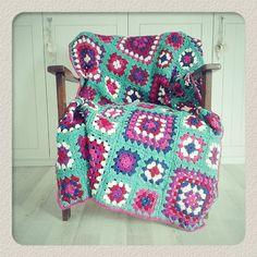 Cheerful crochet granny square blanket.