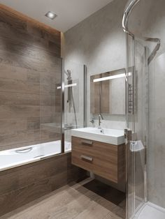 Another beautiful example of how wood effect tiles can transform your bathroom design.