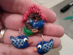 I love birds and birdhouses and so decided to try it out with clay.  I started following another Pinterest post for the house pendant but had to add my own personal touches such as feathers on the bird and a thatched looking roof.  I then found a pattern for the birds.  This set is for a very special friend that needs a little 'bluebird of happiness'.