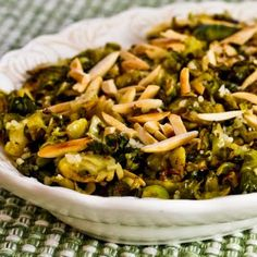 Shredded and Roasted Brussels Sprouts with Toasted Almonds and Parmesan; this is a delicious recipe for Thanksgiving or any time brussels sprouts are in season, and it's Low-Carb and Gluten-Free [from KalynsKitchen.com] #DeliciouslyHealthy #ThanksgivingRecipe