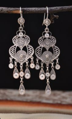 Silver earrings handmade by Ecuadorian artisans with incredible and beautiful details. Although the earrings are large, because is filigree art, the jewelry is not heavy and highlight any outfit.