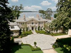 Stately stone manor by Architects Kean Williams Giambertone. On the Sound in Oyster Bay. Style - neo-Colonial house,