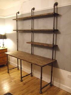 Vintage Industrial Styled Iron Gas Pipe & Reclaimed Timber Planks Desk & Shelving Unit Bespoke finishes, sizes and alternative arrangements of iron pipe frames and shelves can be made to suit the… Cafe Industrial, Vintage Industrial Furniture, Industrial Closet, Industrial Pipe Desk, Industrial Shelving Diy, Vintage Industrial Bedroom, Industrial Style Kitchen, Industrial Chandelier, Industrial Windows