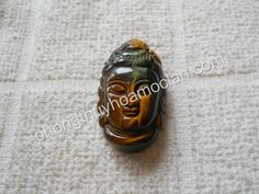 Mặt Phật Thủ đá mắt hổ xanh - mặt dây chuyền Phật phong thuỷ đem lại bình an.