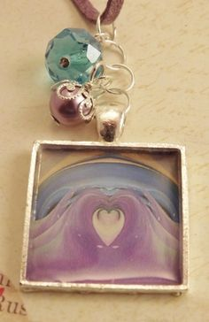 'Blue and Lavender Design Resin Pendant' is going up for auction at  7pm Tue, Nov 13 with a starting bid of $5.