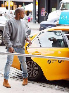Kanye west, grey crewneck sweatshirt, light blue jeans, suede Chelsea boots