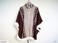 Amazing South American ethnic alpaca wool poncho with two button closure and fringe trim.