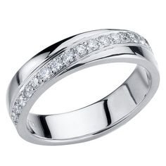 This is one of our more viewed rings. A single row of round-cut diamonds winds around the white gold shank. Eternity Ring Diamond, Diamond Rings, Round Cut Diamond, White Gold, Wedding Rings, Joy, Engagement Rings, Weddings, Jewelry