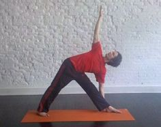 Triangle Pose: From a Warrior II, straighten your front leg, and follow your front hand forward then down to your shin or the floor. Reach your top arm straight up, and bring your body and legs in the same line.    Tips: Keeping both sides of your ribs equally long is easier if you start with your hand up on your shin, and gradually lower from there.    Benefits: Opens hips and thighs.