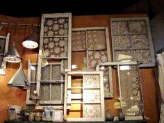 Anthropologie Windows with Lace Doilies! Via Athenastudio on Flickr.