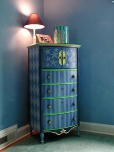 An old family heirloom breeds new life with a star themed nursery with harlequin diamonds and stripes hand painted star knobs.