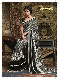 This black & white color Georgette saree gives vintage look