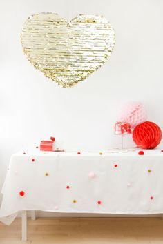 DIY pom pom tablecloth by Studio DIY for The Sweetest Occasion