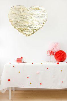 DIY pom pom tablecloth - such a cute idea for birthday party