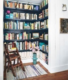 I love the way the dark shelving makes the books look, and of course the pops of turquoise.