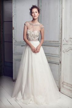 This is a very classic, yet sexy wedding gown. I love the illusion lace across the shoulders and top of the bodice. Gorgeous!
