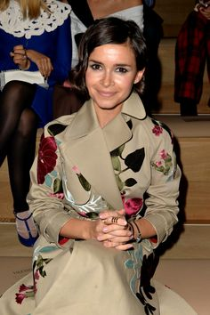 Miroslava Duma wears a trench from the Pre-Fall 2013 Collection at the Prét-à-Porter SS14 Fashion Show in Paris, the 1st of October 2013
