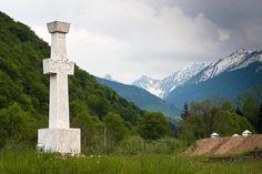 Memorial cross for anitcommunist partisans Romania Brancoveanu monastery Fagaras mountains Carpathians