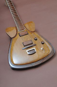 "Jesselli custom Oriental model guitar - This is almost cool, but those ""shoulder pads"" are screaming out to be reworked!. I would enjoy fixing this design."