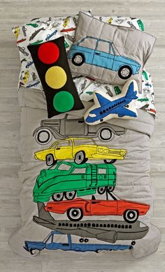 Being stuck in traffic has never been more comfortable, thanks to this exclusive transportation bedding. Made from super soft, 100% cotton, the quilt features a variety of classic vehicles. Add the coordinating sham and sheet set, and your bedroom will be stylish and road-ready.