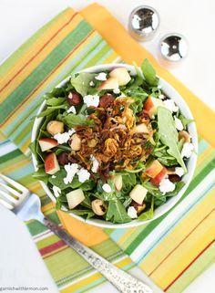 Apple-Arugula Salad with Goat Cheese and Fried Shallots- Garnish with Lemon