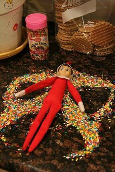 Elf snow angel.  I like the sprinkles because it seems like they wouldn't get the elf as dirty as sugar or flour.