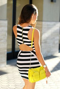 neon purse and black and white dress.