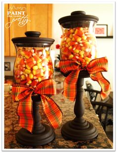 Terra cotta, glass wood candy jar holders. Switch out ribbon to match holiday.