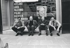 Konrad Lueg, Sigmar Polke, Blinky Palermo and Gerhard Richter sitting in front of their names at Galerie Heiner Friedrich, Cologne 1967.