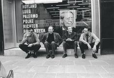 Konrad Lueg, Sigmar Polke, Blinky Palermo and Gerhard Richter sitting in front of their names at Galerie Heiner Friedrich, Cologne 1967.