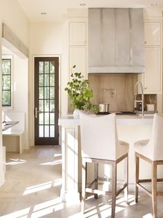 Marble countertops and backsplash, breakfast nook | Dungan Nequette