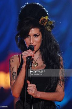 British singer Amy Winehouse performs at The Riverside Studios for the 50th Grammy Awards ceremony via video link on February 10, 2008 in London, England.
