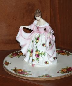 "This is ""Kathryn"" from the Royal Doulton Pretty Ladies series. My wife collects them. Also her fine china pattern is ""Old Country Roses"". Tea Room Decor, Fine China Patterns, Rose Tea, China Dolls, Half Dolls, Antique Roses, Country Rose, Rose Cottage, Royal Doulton"