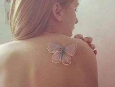 The white butterfly tattoo gives 3D effect in day time and looks shining in night time.