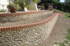 Stone/brick retaining walls - raked out joints so no mortar showing. Brick cap