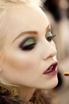 Love that green shadow with wine colored lips!!