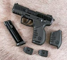 The Ruger SR22 comes with two magazines, two mag finger extensions and two different grip sleeves.