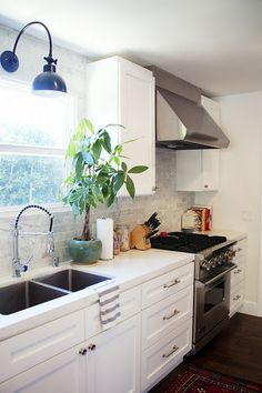 White kitchen, corian countertop, subway tile backsplash, but I'd do glass doors on some of the upper cabinets