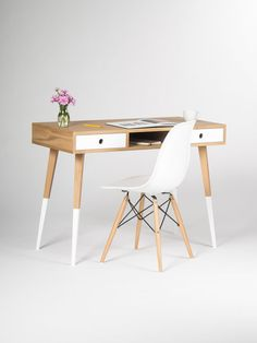 This mid-century masterpiece by MoWdwork is the perfect desk for a small work space. With spindle legs, and white detailing - it's truly unique. Functional as well as beautiful, you can find this desk from Etsy.