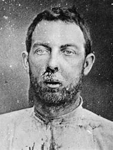 Jim Younger Prison Mugshot  - Born James Hardin Younger on January 15, 1848 & died on October 19, 1902  Rancher, train and bank robber. He committed suicide.
