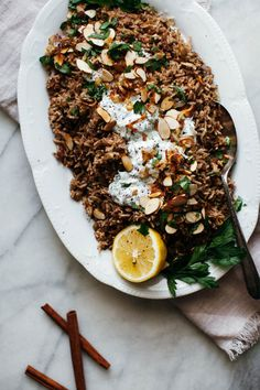 shallot mujadara with herby yogurt and almonds from @yehmolly