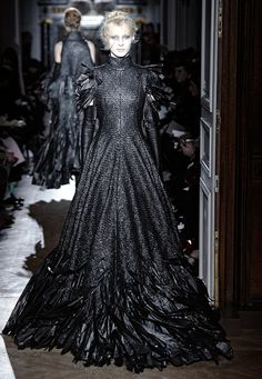 The mother of all trash bag dresses... British fashion designer Gareth Pugh sent models down the runway in dresses made from strips of bin liners during his Paris Fashion Week show. It is tightly woven into a stunning textile.