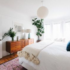 Easy Dorm or Bedroom ideas to DIY: Add Giant Fun Tassels To The Throw You Already Have