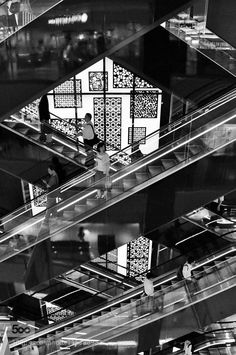 People and escalators by EkaterinaGeorgieva2. Please Like http://fb.me/go4photos and Follow @go4fotos Thank You. :-)