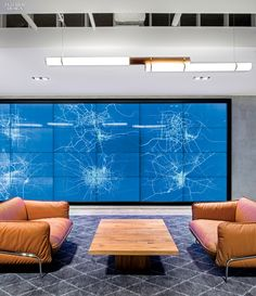 Inside Uber's San Francisco headquarters, the main lounge's LED-embedded touch-screen video wall maps Uber cars in all 100 cities served. Photography by Jasper Sanidad. Corporate Interiors, Office Interiors, Corporate Offices, Interior Design Magazine, Office Interior Design, Commercial Design, Commercial Interiors, Commercial Furniture, Startup Office