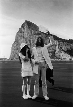 Famously controversial couple, John Lennon and Yoko Ono display their marriage certificate on March 20, 1969.  After their wedding, the couple spent their honeymoon in Amsterdam campaigning with a week-long Bed-In for Peace.