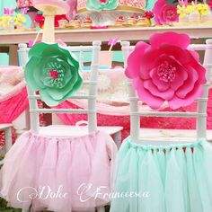 Paper flower decorated chairs at a garden birthday party! See more party planning ideas at CatchMyParty.com!