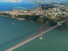 MORE GOOD OLD LISBON - NOW, THE BRIDGE | Flickr - Photo Sharing!Another view over the liquid city. This is the Bridge over the Tejo (or 25 Abril), which was inaugurated back in 1966. Like the Golden Gate at Frisco, is a very lisboan landmark. You can also see the Cristo-Rei statue, similar to Rio de Janeiro's one.