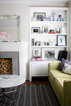 Cool rug, fireplace, alcove shelves