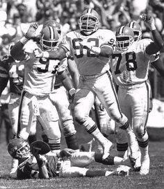 The Plain DealerStar nose tackle Michael Dean Perry's (92, front) big plays helped the Browns make the playoffs in 1988, 1989 and 1994